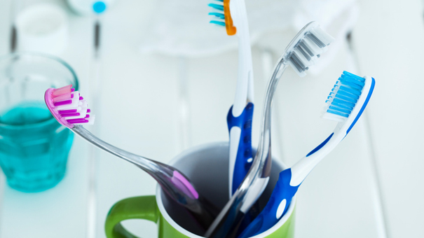 No to the family's toothbrushes in the same storage pot!